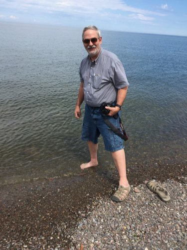 John went so far as to put one foot in Lake Ontario.
